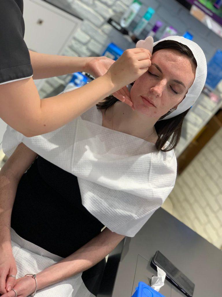 Missy T receiving the Gua Sha Facial Massage