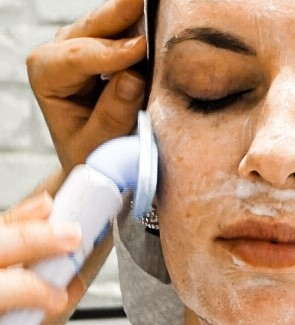 Using the vibrating cleansing pad for the double cleanse element of the facial