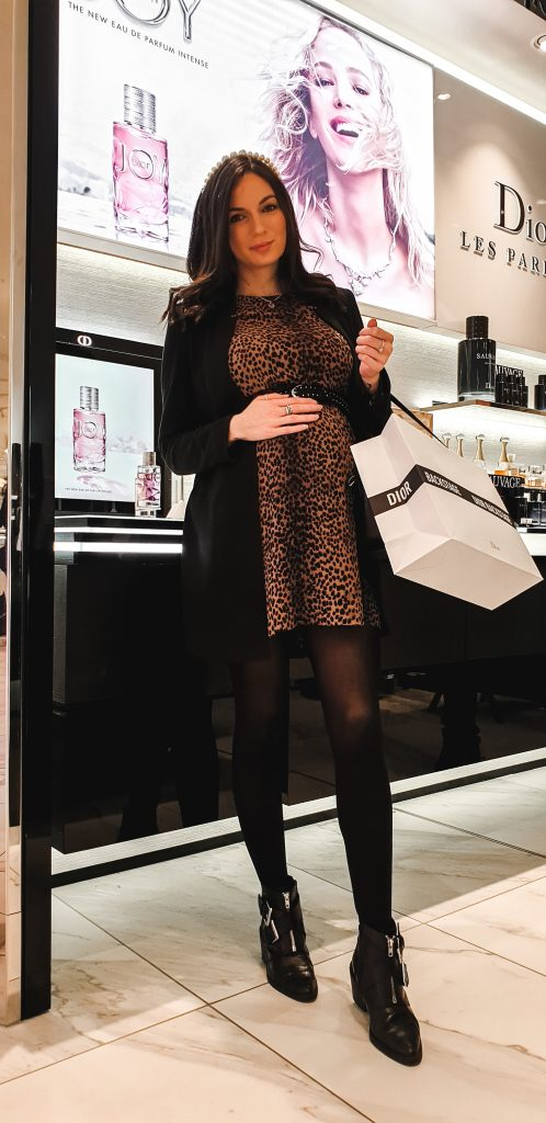 Missy T wearing leopard print dress with Dior Goody Bag